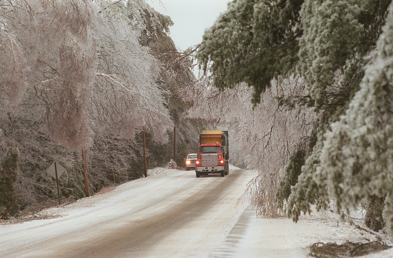 Ice-laden trees bend over, nearly blocking Route 1A in Ellsworth. (NEWS Photo by Bob DeLong)