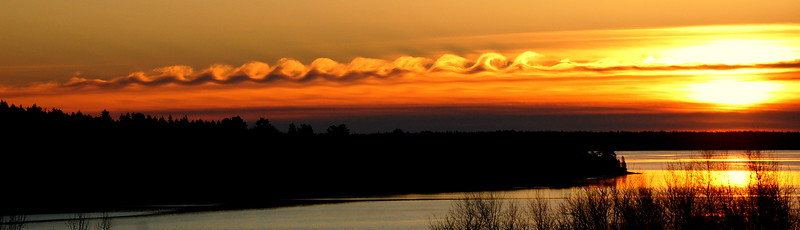 BDN photo by Tom Walsh    Tuesday's Christmas morning sunrise over the seaside Washington County community of Steuben included a most unusual spiral cloud formation that, in effect, created waves in the post-dawn sky.