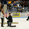 Chris Austin proposes to his girlfriend, Heidi Choate, on center ice of the Alfond Arena after the first period of the University of Maine hockey game.  (BANGOR DAILY NEWS PHOTO BY GABOR DEGRE)<br /> <br /> CAPTION<br /> <br /> Chris Austin proposes to his girlfriend Heidi Choate on center ice of the Alfond Arena after the first period of the University of Maine versus Boston University hockey game.  Choate was under the impression that they were going to be presented with an prize that Austin won.  She said yes to the proposal as the hockey fans cheered and applauded them. BDN photo by Gabor Degre