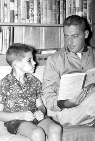 "Captain Donn Fendler shows ""Lost on a Mountain in Maine"" to his son, Dennis , 8, during a visit to Palmyra in July 1962.  BANGOR DAILY NEWS PHOTO BY DON BROUGH"