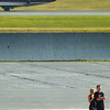 Lance Armstrong and his girlfriend, singer Sheryl Crow, get some fresh air on the tarmac while their chartered jet (not pictured) is refueled early Saturday evening. (BANGOR DAILY NEWS PHOTO BY JOHN CLARKE RUSS)
