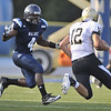 UMaine's Vinson Givans (4) draws a bead on Bryant QB Mike Westerhaus (12) in their game in Orono Sept. 3, 2011.