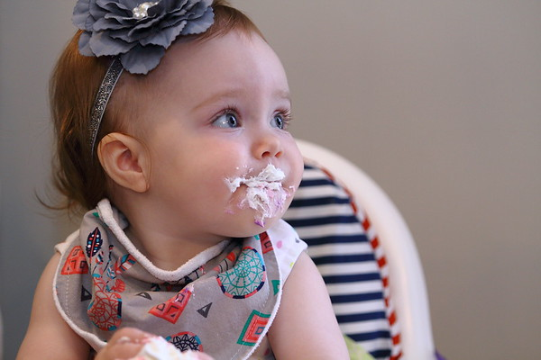 Baby Lucy Enjoying 1st Birthday Cake