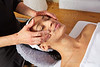 Head massage woman with physiotherapist