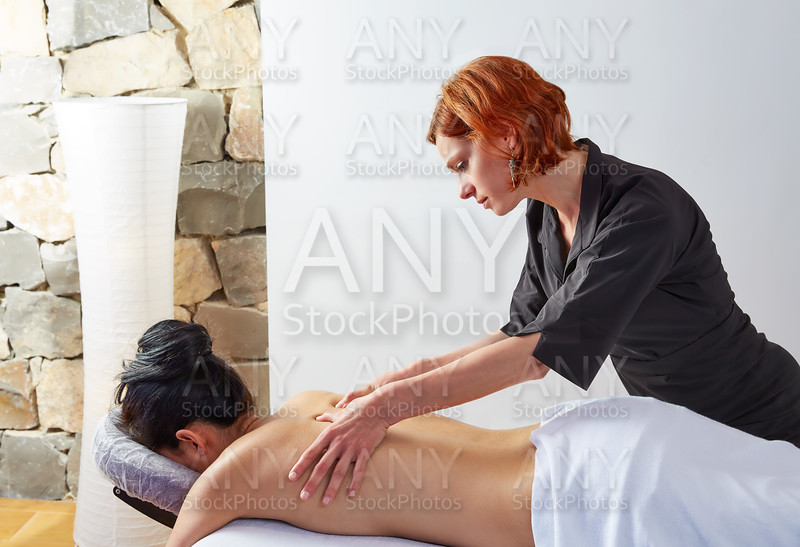 massage in woman back with physiotherapist