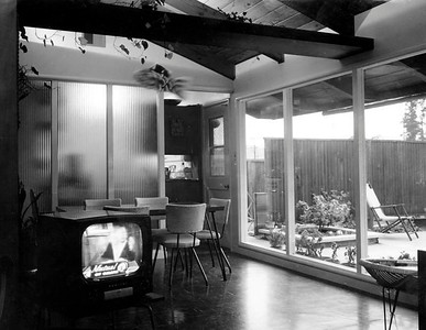 The house and patio at 10 Claire Way as an unwatched Mutual of Omaha commercial runs on that novel modern appliance, the television set.