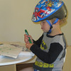 ZACHARY EVEN WEARS HIS HELMET WHILE COLORING