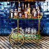 Vintage Design <br /> This Italian bar cart was designed by Aldo Tura for Tura Milano during the 1950s. <br /> Frame and wheels are made of metal and were painted in Gold, the trays are made of lacquered goatskin.<br /> The handle, braces, bottle holder, and wheels are all made from brass, showing detailed ornaments.