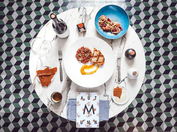 MINE WINE Table setting: beef tartare with egg yolk, Vitello Tonnato, sliced veal and tuna with creamy sauce