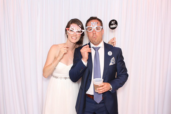 Wedding bespoke booth, featuring a white backdrop and classic props.