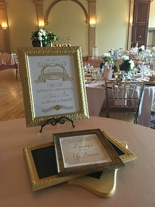 Bridal shower bespoke booth, featuring classic gold framed message boards, a personalized photo booth sign and a custom quote sign.