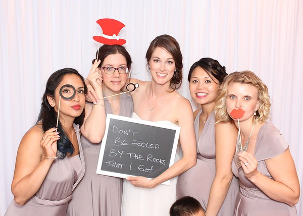 Bridal shower bespoke booth, featuring a white backdrop and classic props.