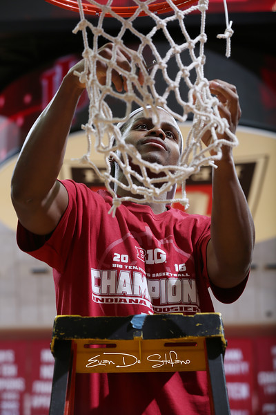 Indiana's Yogi Ferrell cuts down the net after defeated Maryland in Assembly Hall on Mar. 3, 2016. Beating Maryland meant winning the Big Ten title and ending the season undefeated at home.
