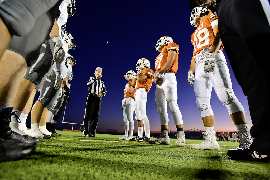 . The captains from Mead High School and Roosevelt High School watch the coin toss before the start of the game in Mead, Colorado on Oct. 6, 2017.  (Photo by Matthew Jonas/Times-Call)