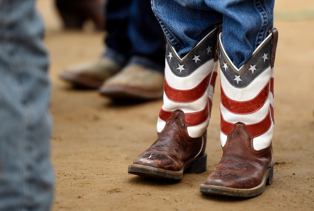. Elliot Garrimone wears his American flag cowboy boots before riding a sheep during the Mutton Busting event on Thursday at the Boulder County Fairgrounds in Longmont. For more photos of the event go to dailycamera.com Jeremy Papasso/ Staff Photographer/ Aug 3, 2017