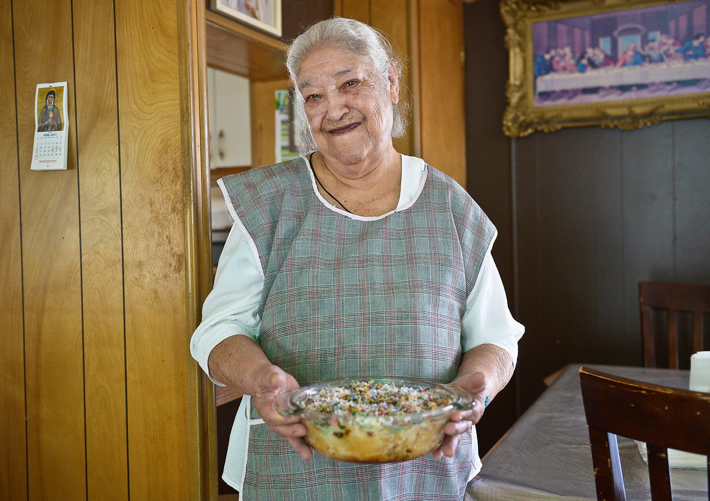 . Teresa Soto, 83, holds migas capirotada, a traditional Mexican dessert, which she prepared for Lent. Lewis Geyer/Staff Photographer April 07, 2017