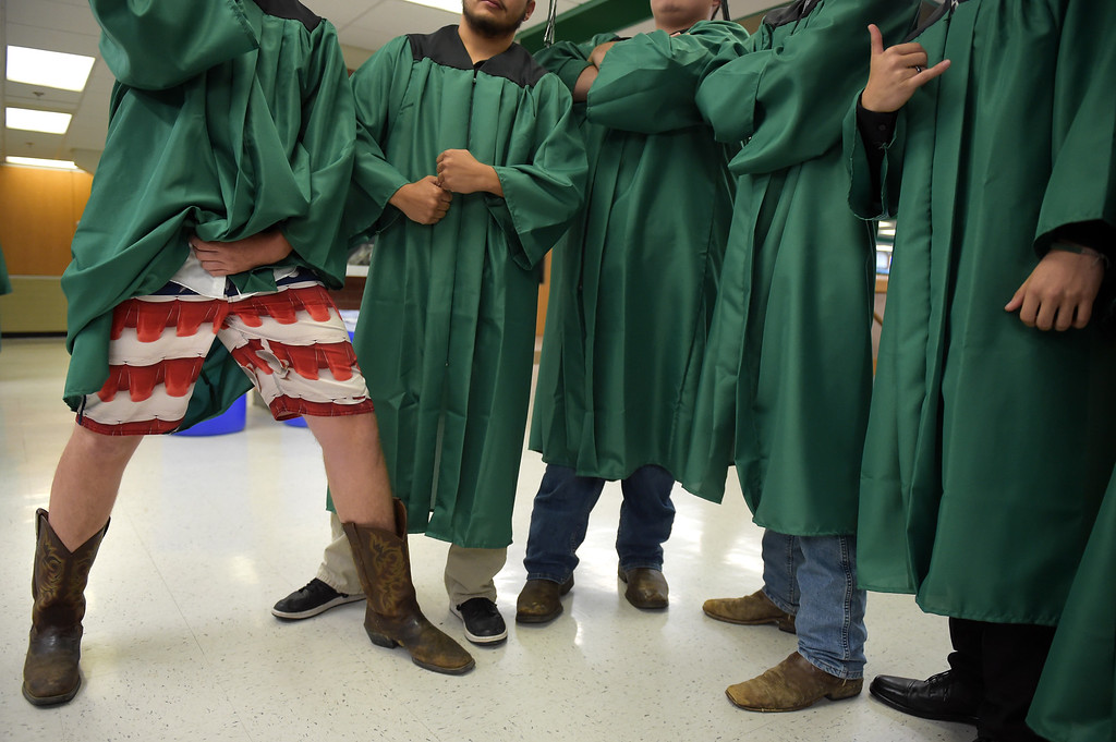 . John Hibar, left, poses for a photo with his classmates before commencement at Niwot High School. Lewis Geyer/Staff Photographer May 27, 2017