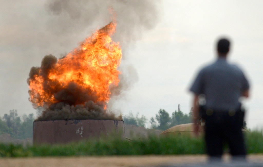 . An oil tank burns at the scene of an explosion near the Grand View Estates neighborhood in Mead. One person died in the explosion. Lewis Geyer/Staff Photographer May 25, 2017