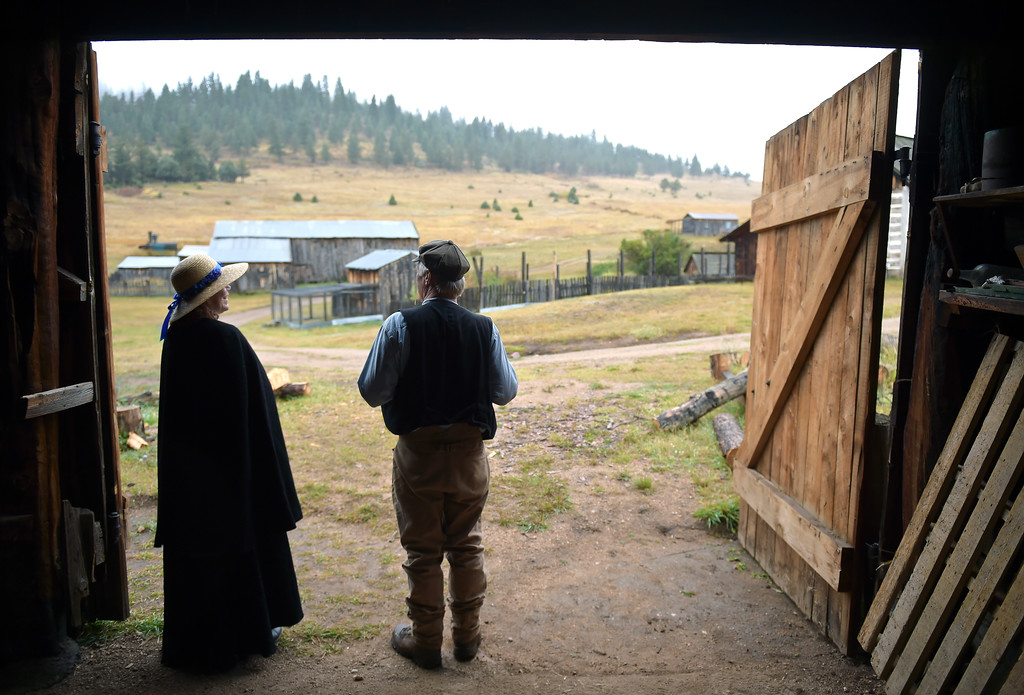 . Volunteer Barb West and seasonal education outreach employee John Reed stay out of the cool, damp weather at the entrance to the wagon barn during the Walker Ranch Fall Heritage Day.  Lewis Geyer/Staff Photographer Sept. 24, 2017