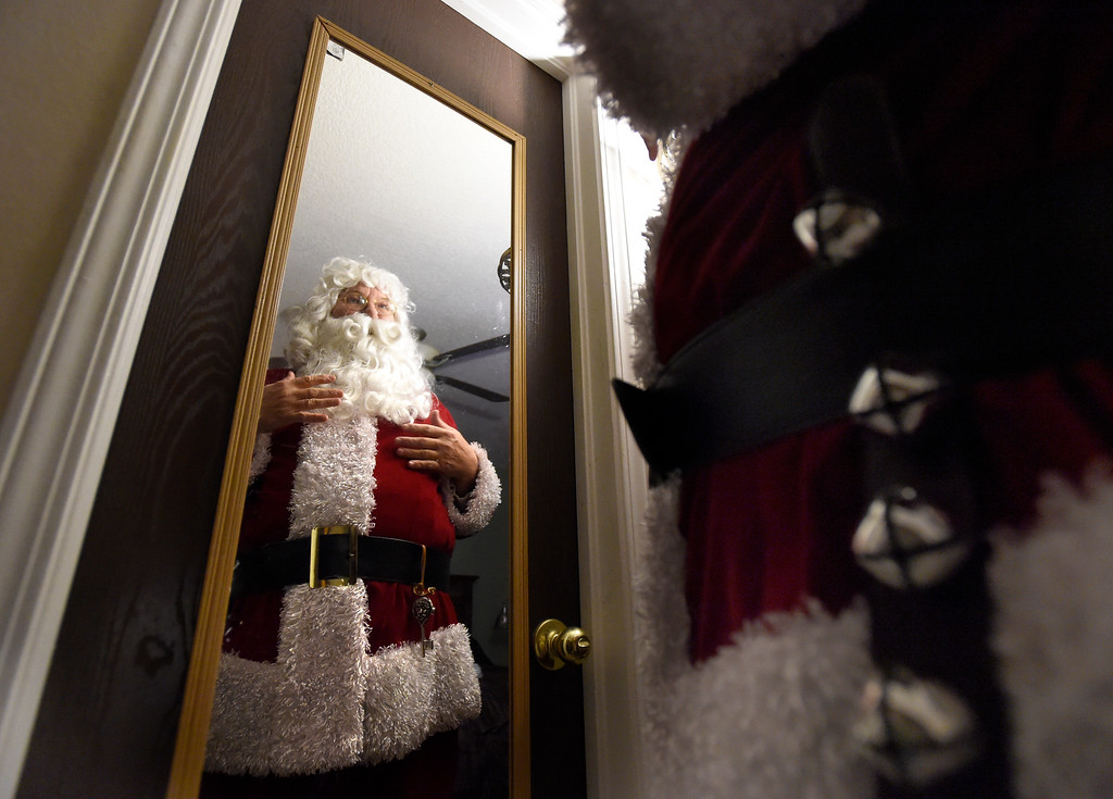 . BEST 1. Santa Marty Parks, of Lafayette, uses a mirror to inspect his costume at his home on Friday night before heading to an event in Erie. For more photos and video of Santa Marty Parks go to dailycamera.com Jeremy Papasso/ Staff Photographer 12/08/2017