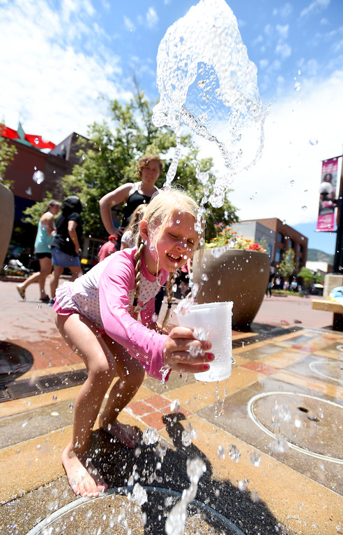 . BEST 1 Sophia Sexaurer plays in the water fountain on the Pearl Street Mall  during a day in the 90\'s. For more photos, go to www.dailycamera.com.  Cliff Grassmick  Staff Photographer June 20, 2017