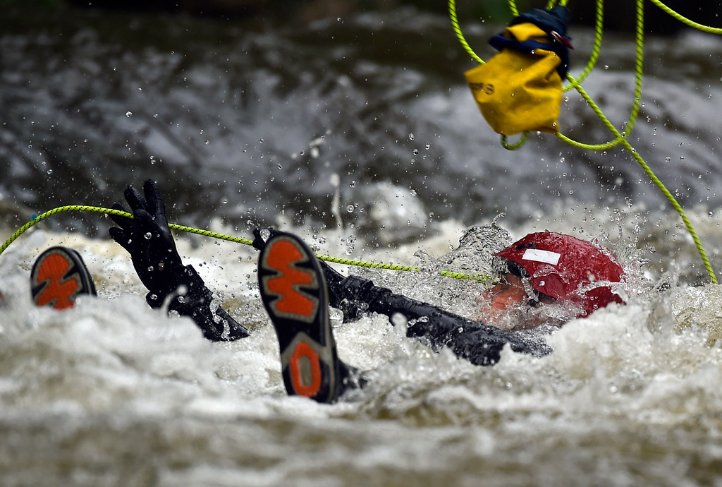 . Boulder Fire Rescue Lieutenant Brian Marron grabs a throw bag during a swift-water rescue training exercise on Tuesday, June 6, at the Boulder Creek in Boulder. For more photos and video of the swift-water rescue training Jeremy Papasso/ Staff Photographer/ June 6, 2017