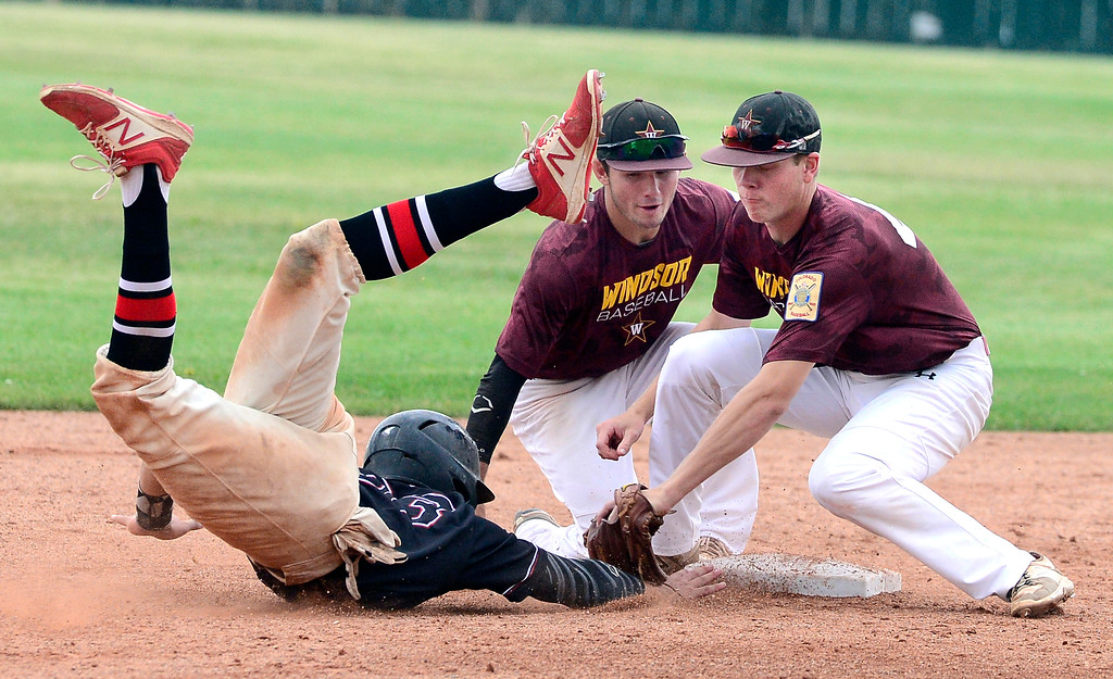 . Fairview Knights\' Jeff Erickson gets caught off 2nd base as Windor\'s Bailey Brachtenbach during their game in Boulder on Wednesday. Shortstop Braden Peninger backs up Brachtenbach. For more photos go to bocopreps.com.  Paul Aiken Staff Photographer July 26, 2017