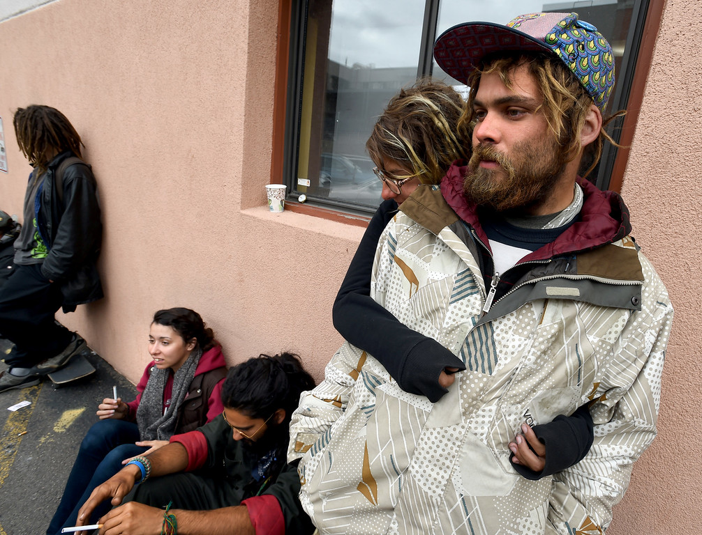 . BEST 2  Steve and Kyla wait with other homeless people for Deacon\'s Closet to open on Thursday. Homeless people wait outside Deacon\'s Closet to pick up clothing. This clothing bank is part of the First Presbyterian Church in Boulder. Cliff Grassmick  Staff Photographer April 27, 2017