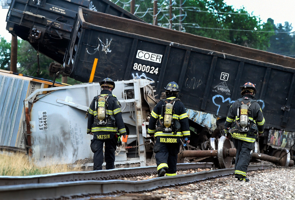 . Firefighters investigate a train derailment on Tuesday, June 20, near 63rd Street in Boulder. Jeremy Papasso/ Staff Photographer/ June 20, 2017