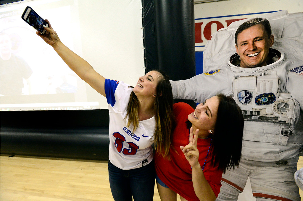 . Lindsey Rosen, left and Jaime Krull, both seniors at Centaurus High School get a selfie with astronaut Jack Fischer after Fischer\'s call to the school from the International Space Station. Fischer is a graduate from the school in Lafayette. For more photos go to dailycamera.com. Paul Aiken Staff Photographer Thursday August 31, 2017