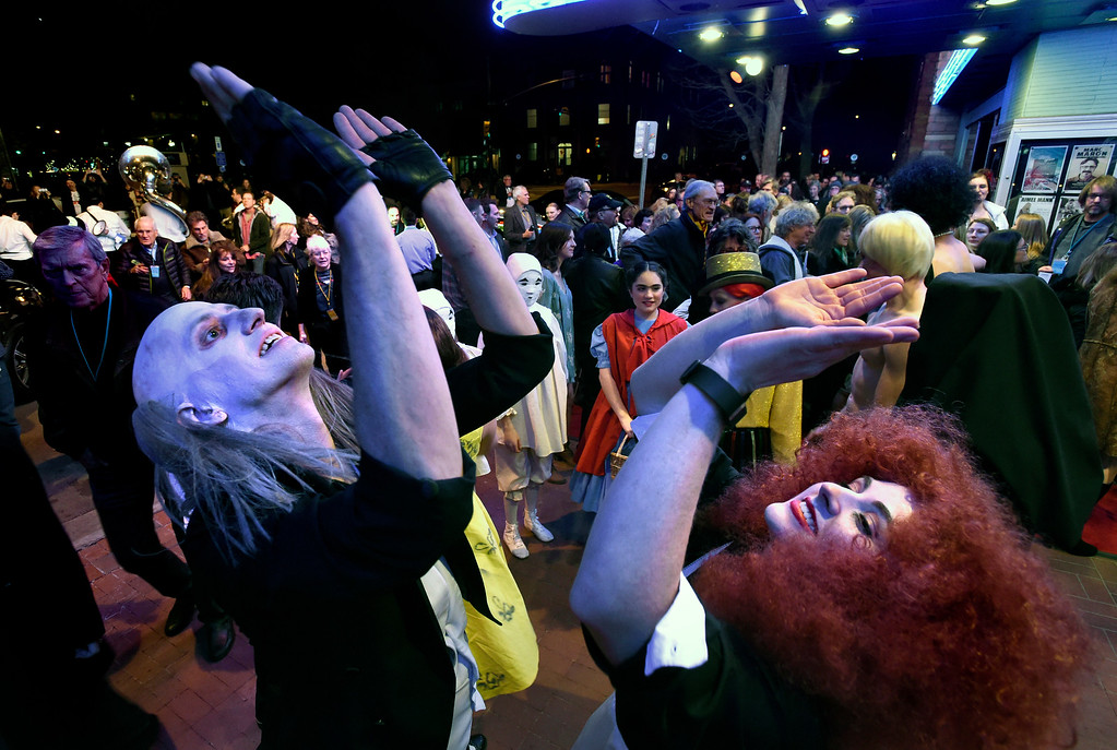 . Kenn Penn, dressed as Riff Raff from the Rocky Horror Picture Show, at left, and Tessa Warner, dressed as Magenta also from the Rocky Horror Picture Show, dance on the red carpet in front of the Boulder Theater during opening night of the Boulder International Film Festival on Thursday in Boulder. For more photos and video of the 2017 BIFF opening night go to www.dailycamera.com Jeremy Papasso/ Staff Photographer/ March 2, 2017