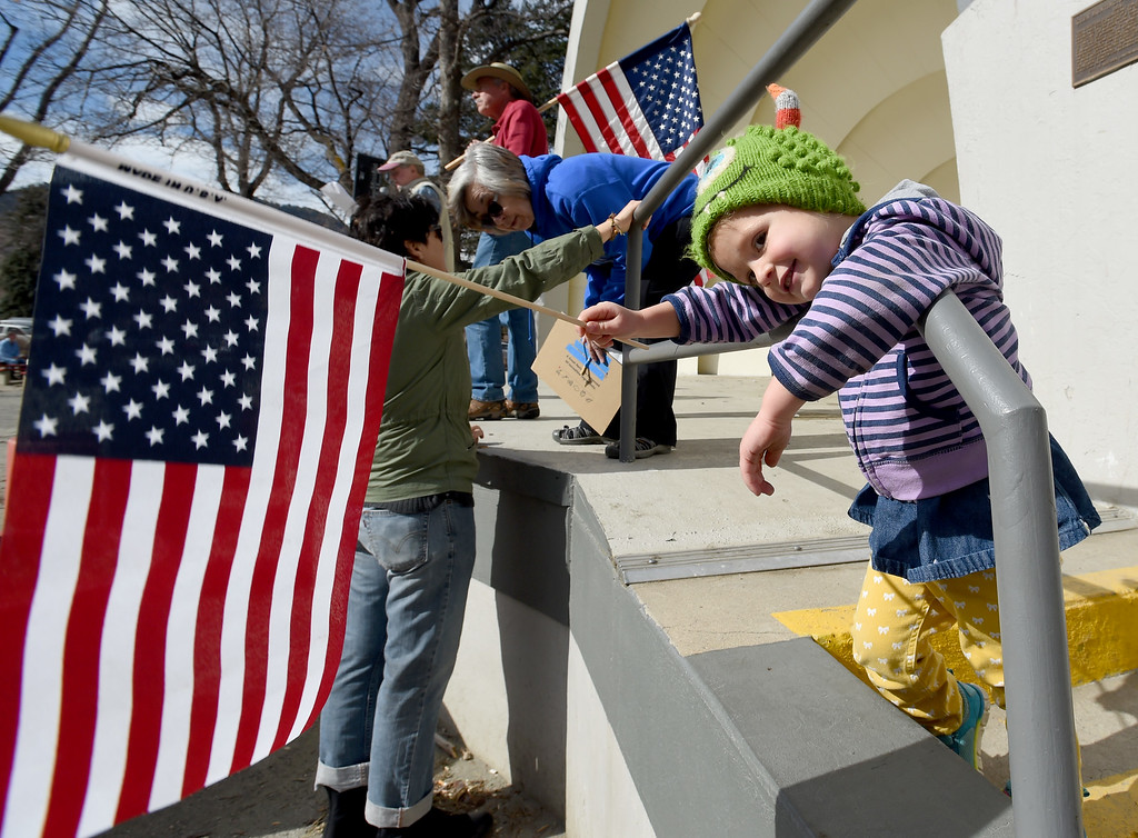 ". Gianna O\'Connell, 2, shows her support for the US Flag before the march to downtown Boulder. Gianna O\'Connell, 2, shows her support for the US Flag before the march to downtown Boulder.  About 500 people marched in the ""This Is What Democracy Looks Like\""  anti-Trump protest for the second Saturday in a row around downtown Boulder. Cliff Grassmick  Staff Photographer  February 11, 2017"