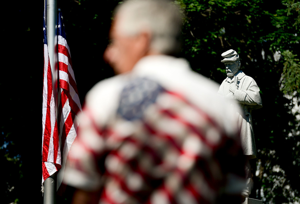. Don Hostetter, of Longmont, wearing a flag themed shirt, waits at the Civil War memorial statue for a Memorial Day remembrance to begin on Monday. More photos: TimesCall.com. Matthew Jonas/Staff Photographer May 29,  2017
