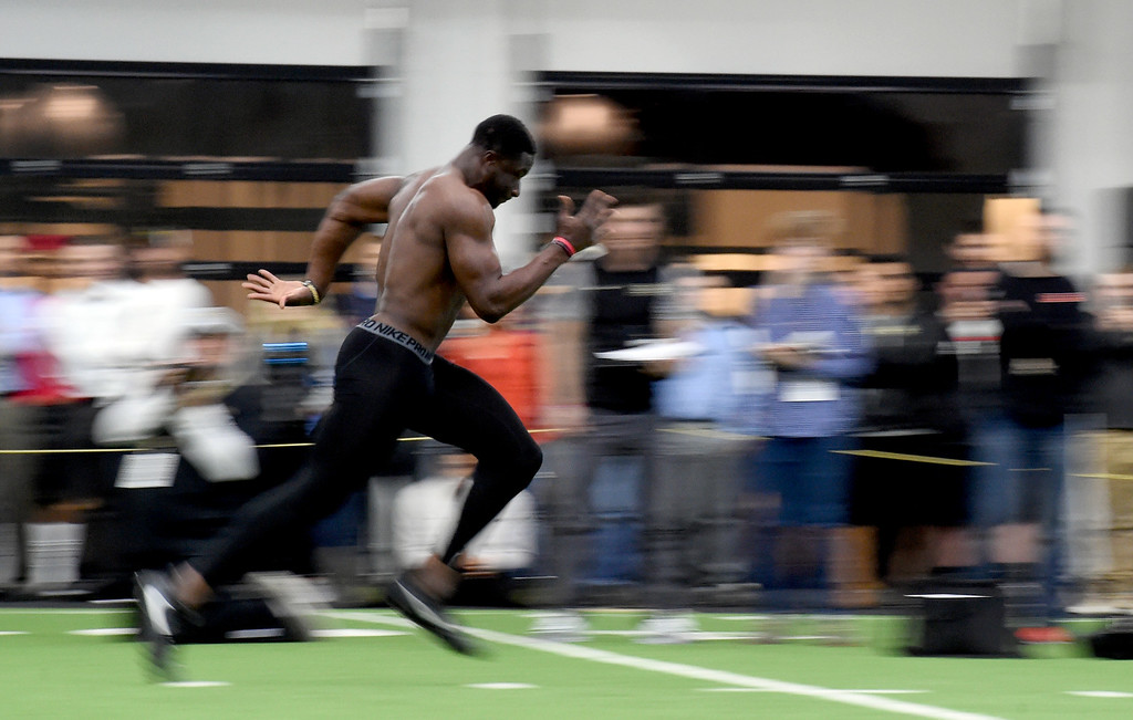 . Jaleel Awini runs the 40 for scouts.  Former University of Colorado football players showed their skills to NFL scouts on Wednesday at CU\'s pro timing day at the Indoor Practice Facility. For more photos, go to www.buffzone.com. Cliff Grassmick  Staff Photographer March 8, 2017