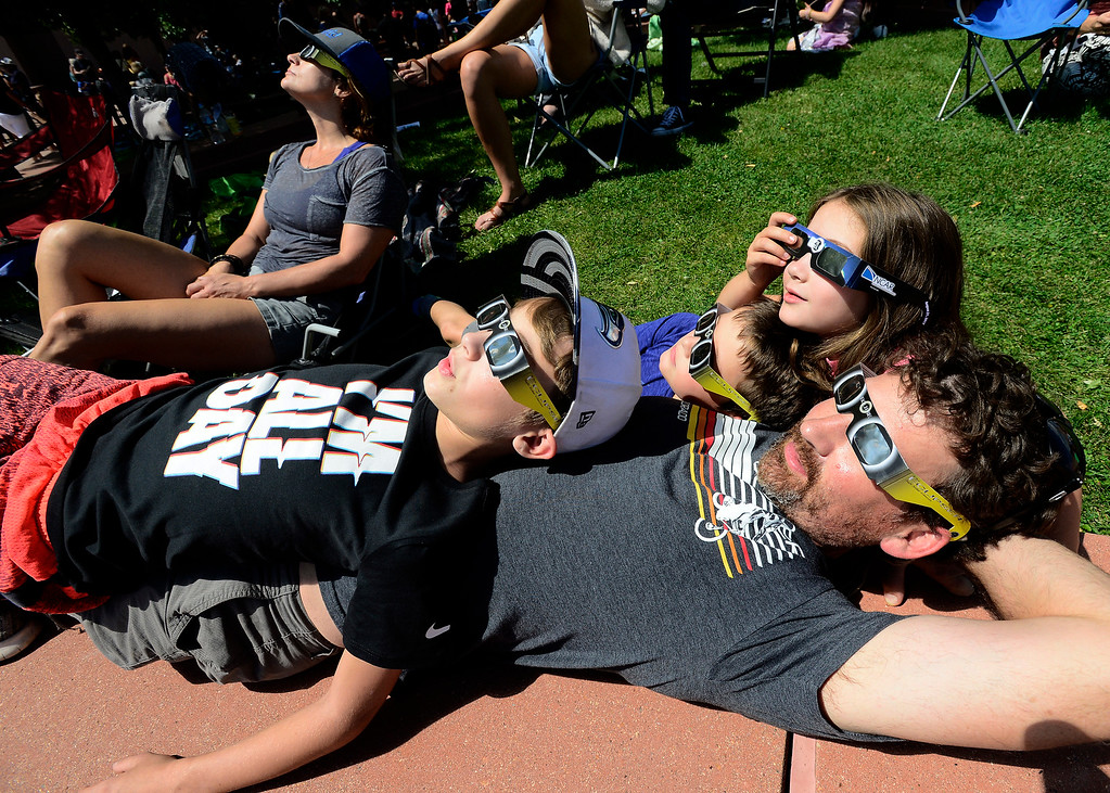 . Arlo and Danielle Corwin watch the eclipse with their kids from left to right Corwin, 10, Levi, 7, and Asa 7, at NCAR in Boulder on Monday. For more photos and video go to dailycamera.com.  (Photo by Paul Aiken/Daily Camera)
