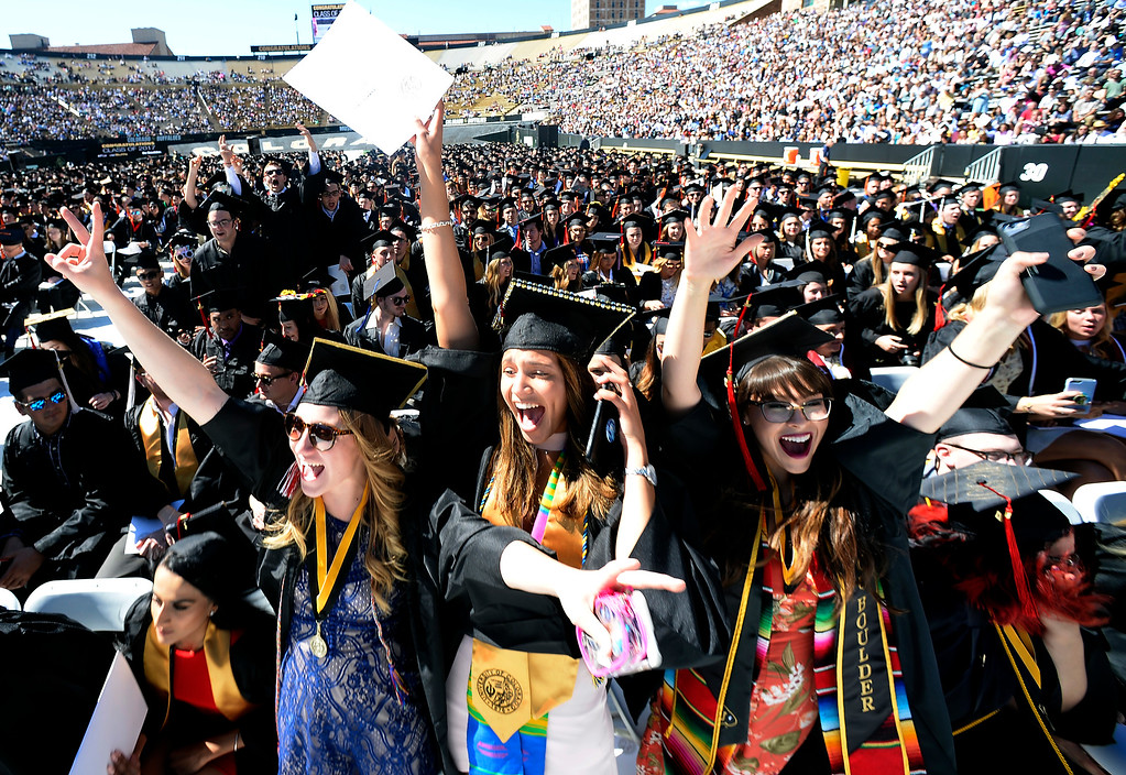 . Jordyn Siemens, left, Halle Jones, and Hayley Sanchez, get excited when their school is called out during the May 12, 2017 University of Colorado Commencement on Friday. For more photos and a video, go to www.dailycamera.com  Cliff Grassmick  Staff Photographer May 12, 2017
