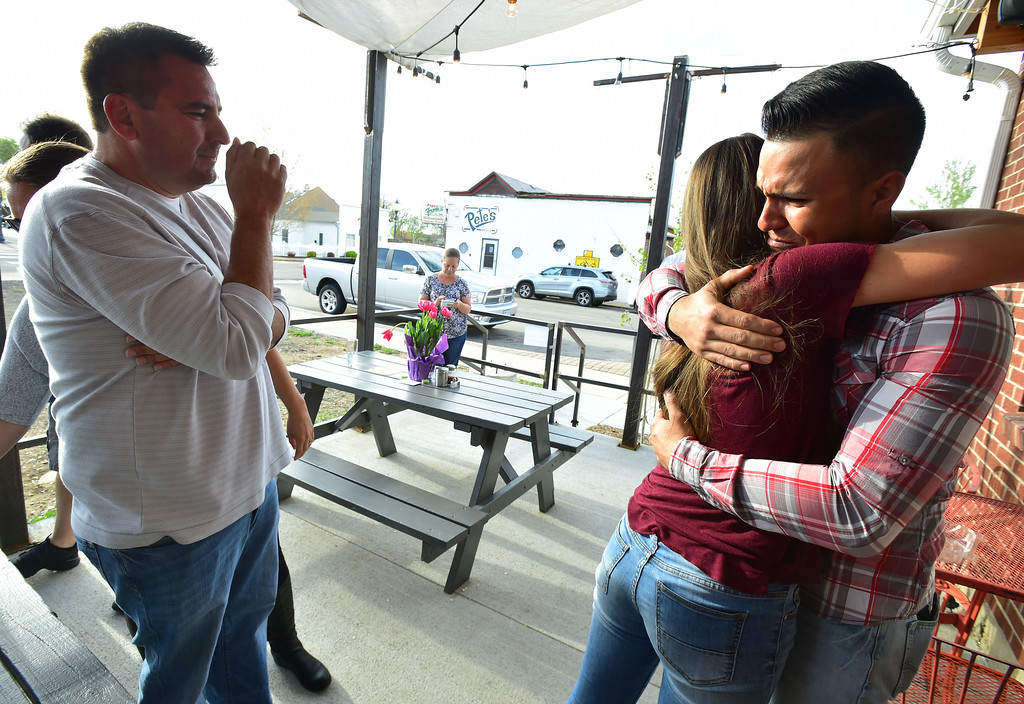 . Hallee Hurtado, a niece to Joey Irwin and Mark and Erin Martinez hugs Christian Vasquez during a gathering for friends and family in Frederick Colorado on Sunday evening. Vasquez was one of the crew of workers nearby that rushed to the scene of an explosion at the Martinez house to save Erin from building. Looking on his Hallee\'s dad Bo Hurtado. Joey Irwin and Mark Martinez were killed in the explosion.  For more photos go to www.dailycamera.com Photo by Paul Aiken / Staff Photographer / April 23 2017
