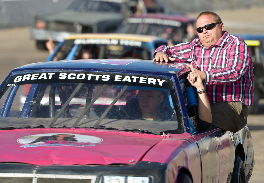 . Makayla Grote\'s father Troy Grote rides a car his daughter used to race during a memorial service for Makayla at Colorado National Speedway. Lewis Geyer/Staff Photographer Nov. 26, 2017