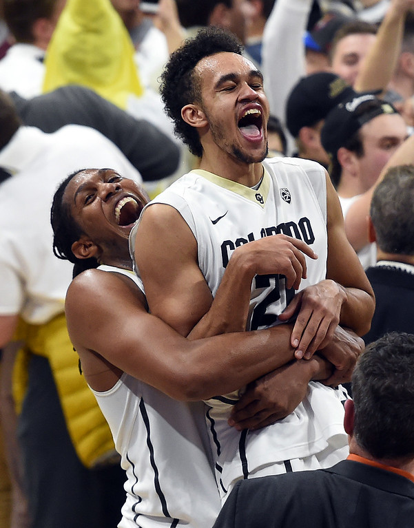 . Xavier Johnson picks up Derrick White after the Buffs upset Oregon during the January 28, 2017 game in Boulder, Colorado. Cliff Grassmick / Staff Photographer / January 28, 2017