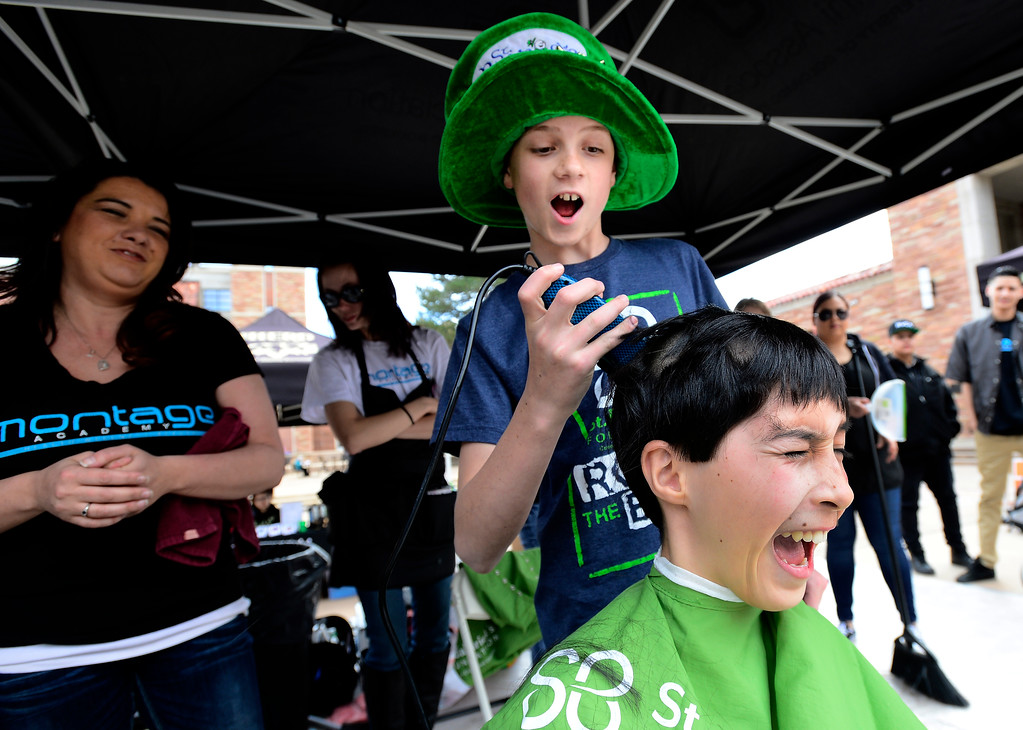 . Luke Plotnick, 13,  begins to shave his friend\'s Addison Kleinhans\' head at the St. Baldrick\'s fundraiser on the CU Boulder Campus on Wednesday. Plotnick\'s lost his brother James to cancer and Keinhans, 12, is in remission from his 2010 cancer diagnosis and 38 months of chemotherapy.  For more photos and video go to www.dailycamera.com Paul Aiken Staff Photographer March 15 2017