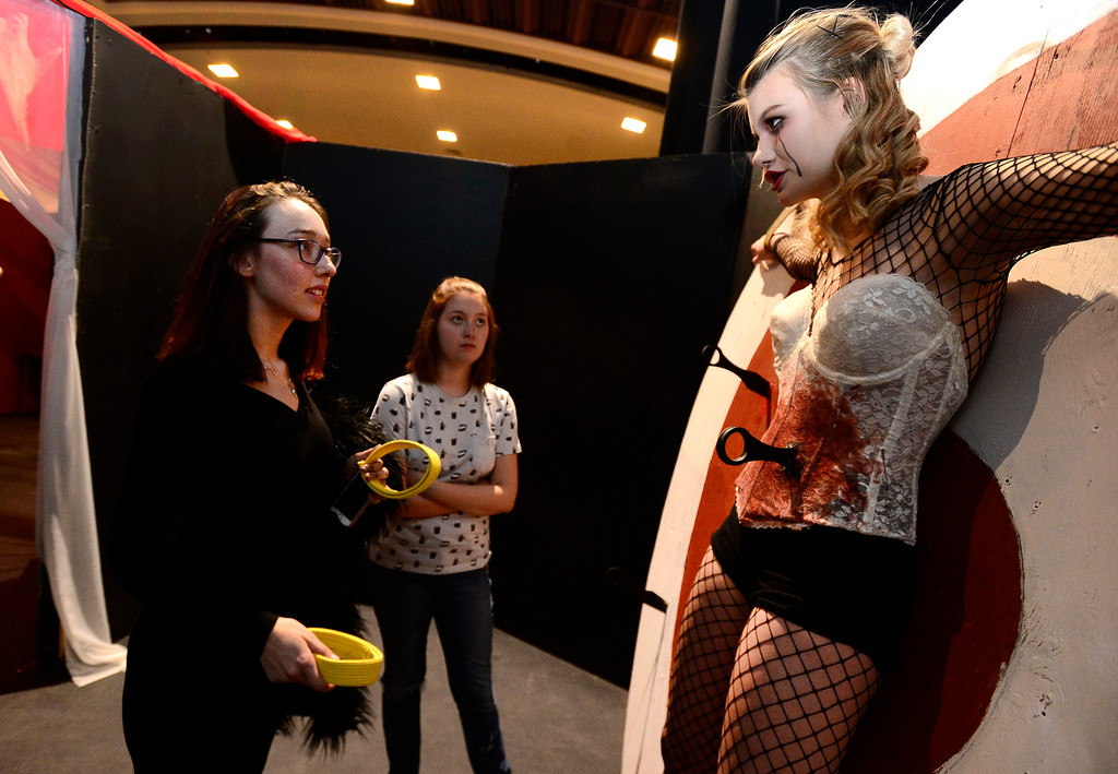 . Daisy Ellis, Co-Director talks with Morgan Robers about her character\'s role during rehearsal for Boulder High Theater\'s Legendary Haunted House at the school on Thursday afternoon. Gwen Egan is the technician who will be turning the wheel Robers is strapped to.  The Haunted House is open from 7 to 10 p.m. Oct. 20, 21, 27, 28 and 31 with a sensory-friendly lights on session from 6 to 7 p.m. on the 28th.  Paul Aiken / Staff Photographer / Oct 19 2017