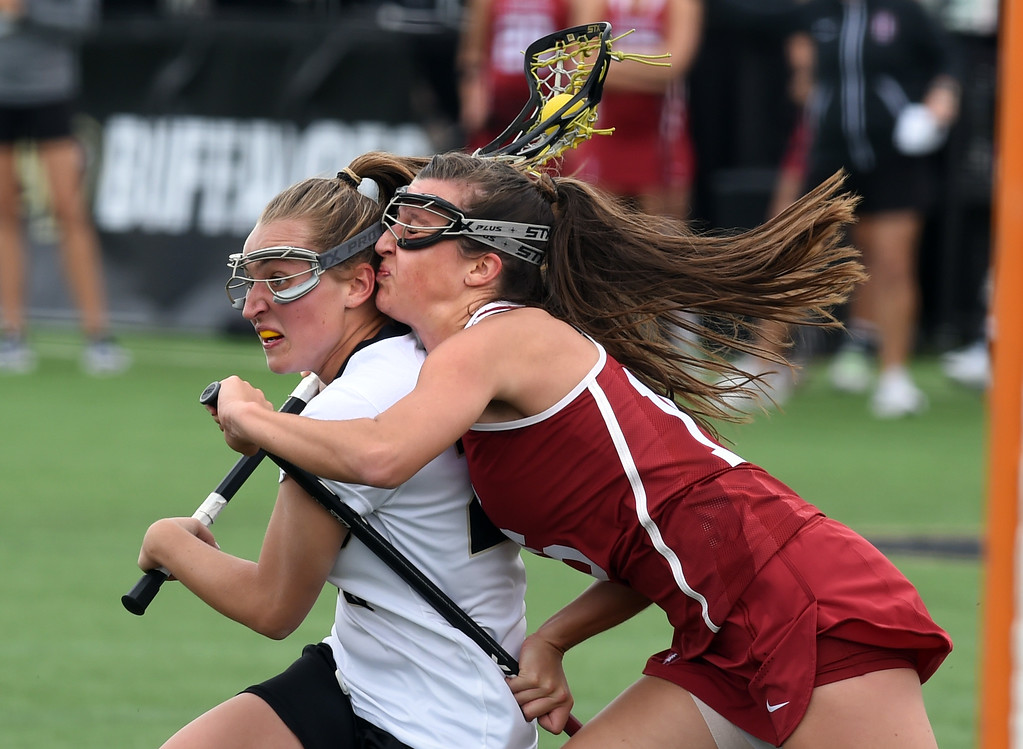 . Darby Kiernan, left, of CU, battles with Madison O\'Leary, of Stanford, during the April 7, 2017 game in Boulder. For more photos, go to www.buffzone.com. Cliff Grassmick  Staff Photographer April 7, 2017