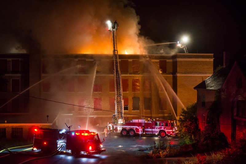 Fire vents from the roofline during the 4th Alm at the former BF Brown School. SENTINEL&ENTERPRISE/ Jim Marabello