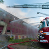 Water pours from the front door of the former BF Brown sdchool during the 4th Alm fire. SENTINEL&ENTERPRISE/ Jim Marabello
