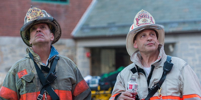 Fitchburg Fire Chief Kevin Roy (left) and Deputy Chief Tad Dateo watch efforts to congtain the 4th Alm fire at the BF Brown School. SENTINEL&ENTERPRISE/ Jim Marabello
