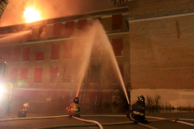 Firefighter work on putting out the fire at the B.F. Brown School in Fitchburg on Monday morning around 5 a.m. The fire start a little around 4 a.m. SENTINEL & ENTERPRISE/JOHN LOVE