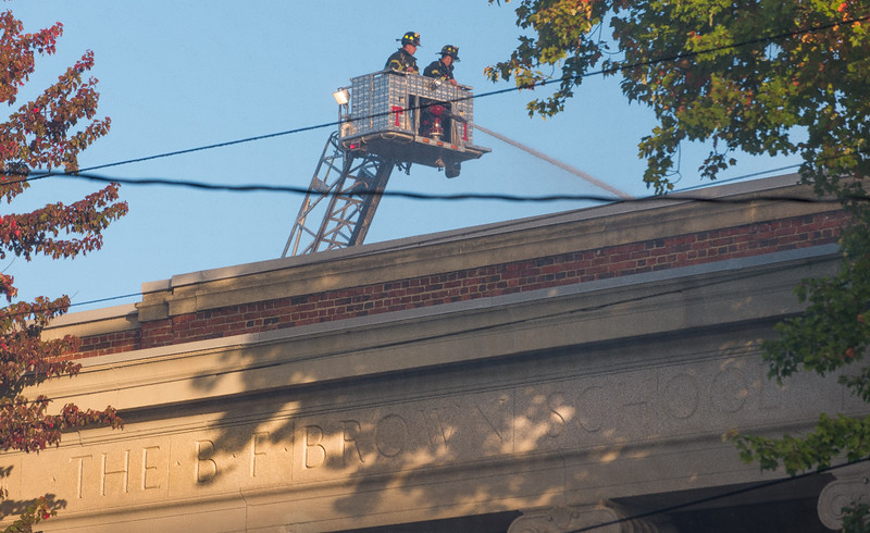 Gardner firefighters in Tower 1 hover above the BF Brown School during a 4th Alm at the vacanat school. SENTINEL&ENTERRPISE/ Jim Marabello