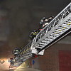 Leominster's ladder 1 crew on the aerial<br /> 	SENTINEL & ENTERPRISE/Scott LaPrade