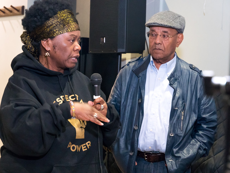 One of numerous speakers who rose to ask questions of the speakers.