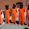 Witness To Torture members dressed in prisoner jumpsuits and masks. This was a dramatic reminder of the barbaric conditions used against thousands of Muslim men taken prisoner and subjected to unlimited detention  in the wake of 911.